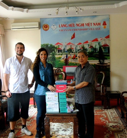 Joerie (left) and Yaiza (middle) from The One Chance Project donating medical supplies to Mr. Dong (right) from The Friendship Village
